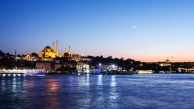 Istanbul cityscape with Suleymaniye mosque with tourist ships floating at Bosphorus at night. Istanbul cityscape with Suleymaniye mosque with tourist ships Stock Images