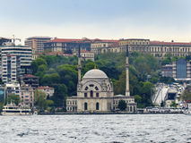 Istanbul Dolmabahce Mosque and Bosphorus views. Dolmabahce Palace in Istanbul, built by Bezmeni Alem Valide Sultan Dolmabahçe Mosque. Design by Garabed Balyan Royalty Free Stock Photo