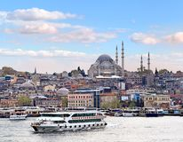 Istanbul at dusk. Istanbul skyline  with ferries on the golden horn waters Stock Photo