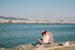 Istanbul Embankment with a pair of tourists in love with travelers. Istanbul, Turkey royalty free stock photos