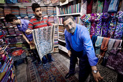 Istanbul Fabric Merchant and Sons. ISTANBUL, TURKEY – APRIL 26: Fabric merchant and sons inside the Grand Bazaar in Istanbul prior to Anzac Day on April 26 Stock Photography