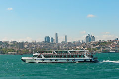 Istanbul ferry. Traditional Istanbul ferryboat, Istanbul city on the back Royalty Free Stock Images