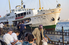Istanbul, ferry in Karakoy pier. Port looks everyday life. Royalty Free Stock Photography
