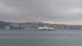 Istanbul ferry sailing in Bosphorus on a cloudy and rainy day, Istanbul, Turkey stock footage