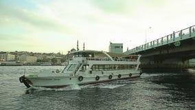 Istanbul Galata bridge. ISTANBUL, TURKEY - SEPTEMBER 28, 2013: Tourist ship passing under the Galata bridge stock footage