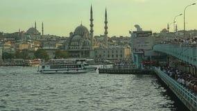 Istanbul Galata bridge. ISTANBUL, TURKEY - SEPTEMBER 28, 2013 Tourist ship passing under the Galata bridge stock video footage
