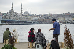 Istanbul, grilled fish, people who eat fish on the beach bread. Royalty Free Stock Photo