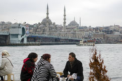 Istanbul, grilled fish, people who eat fish on the beach bread. Royalty Free Stock Image
