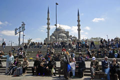 Istanbul and its people. Scenes of daily life in Istanbul, on the background shows the beautiful new mosque Yeni Camii stock images