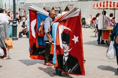 Istanbul, June 15, 2017: Authentic scene. Pitchman. A small business for selling various flags on Turkish subjects. Istanbul, June 15, 2017: Authentic photo stock image