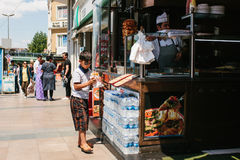 Istanbul, June 11, 2017: Little boy buying gyros from street vendor Stock Photos