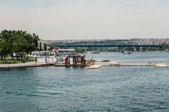 Istanbul, June 17, 2017: Local jetty or ferry or port on the Bosporus for transportation of city residents by water royalty free stock photo