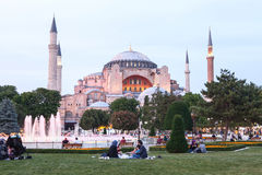 Istanbul, June 16, 2017: Many people of the Islamic religion take food on the Sultanahmet square next to the blue mosque Royalty Free Stock Photos