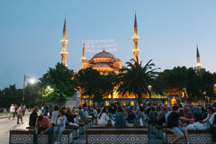 Istanbul, June 16, 2017: Many people of the Islamic religion take food on the Sultanahmet square next to the blue mosque Stock Image