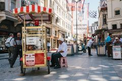 Istanbul, June 14, 2017: Sale of a traditional Turkish bagel called Simit. Turkish street food. stock image