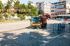 Istanbul, June 16, 2017: Street janitor using cleaning machine to sweep and clean sidewalk tile Stock Photography