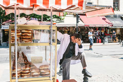 Istanbul, June 15 2017: Stressed out and upset street bakery product vendor having bad headache Royalty Free Stock Images