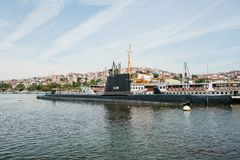 Istanbul, June 17, 2017: A submarine and a ship near the shore next to apartment buildings in the European part of the royalty free stock photo