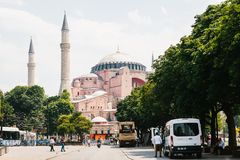Istanbul, June 15, 2017: Sultanahmet Square. A lot of people and cars. Ahead of the mosque is Aya Sofia. An ordinary day. Sultanahmet Square. A lot of people and stock photo