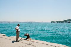 Istanbul, June 17, 2017: Traditional Turkish fishing hobby. A local fisherman is fishing on the shore. Ordinary life in. Turkey Stock Image