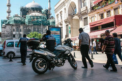 Istanbul, June 15, 2017: Two Fatih district police officers on duty and random curious passerby are wondering what is Stock Photography
