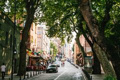 Istanbul, June 15, 2017: View of an authentic street with shops and cafes with carpeting. The usual urban life of people. And typical architecture royalty free stock photos