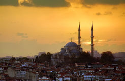 Istanbul just before Sunset. The Fatih Mosque punctuates Istanbul's Skyline at Sunset Stock Photos
