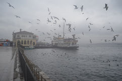 Istanbul, Kadikoy. Foggy morning, waiting to ferry passengers an Stock Photo