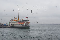 Istanbul, Kadikoy. Foggy morning, waiting to ferry passengers an Stock Photos