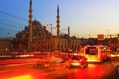 Istanbul, Long exposure. Galata Bridge and Yeni Mosque in Istanbul. Long exposure with traffic movement Stock Photos