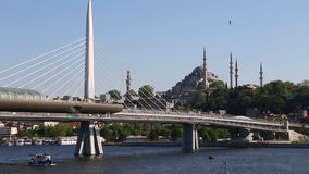 Istanbul metro station in Golden Horn, Halic, zoom in view with Suleymaniye Mosque stock footage