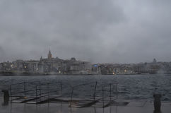 Istanbul, misty rain on a cold winter morning. Galata Tower and Stock Photography
