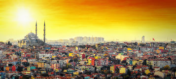 Istanbul Mosque with colorful residential area in sunset. Istanbul Mosque Suleymaniye with colorful residential area in sunset with orange sky stock image