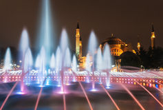 Istanbul mosque - Hagia Sophia at night fountain. The Hagia Sophia Byzantine architecture and fountain illuminated at dusk, famous historic landmark and world stock images
