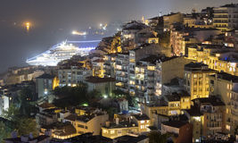 Istanbul at night. A view of the city of Istanbul with a cruise ship docked for the night stock photos