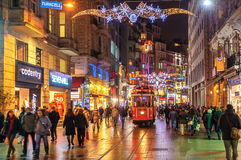 Istanbul Nostalgic Tramway on Istiklal Street at night, Istanbul. ISTANBUL, TURKEY - February 22: Nostalgic tramway on the main pedestrian Taksim Istiklal Street stock photo