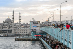 ISTANBUL - NOV, 21: Fishermen at the crowded Galata bridge with Stock Photos