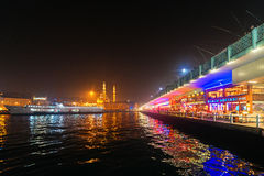 ISTANBUL - NOV, 19: Galata bridge with fishermen above and the r Royalty Free Stock Image