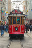 ISTANBUL - NOV, 21: A red classic tram in the crowded Istiklal A Stock Photography