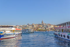 Istanbul passenger boats. ISTANBUL, TURKEY - SEPTEMBER 28, 2013: Passenger boats depart from the pier Bogaz Iskelesi, overlooking the Galata Tower Royalty Free Stock Images