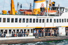 ISTANBUL. People get on board the ship at Karakoy Pier royalty free stock photos