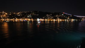 Istanbul`s bridge and hills at night stock video