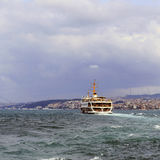 Istanbul's Golden Horn water transport ship with water waves. Stock Images