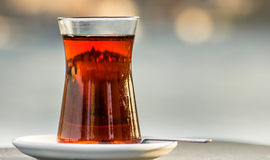Istanbul's silhouette reflected on a Turkis tea cup Stock Photo