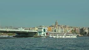 Istanbul ship passes under the Galata bridge. ISTANBUL, TURKEY - SEPTEMBER 29, 2013 Tourist ship passes under the Galata bridge, view from a boat that sails stock video footage