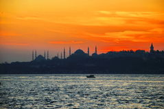 Istanbul silhouette. Blue Mosque and Hagia Sophia at sunset Stock Photos