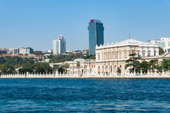 Istanbul skyline as viewed from the sea. Cityscape with clear blue sky on the background. Modern buildings of Istanbul Besiktas district with Dolmabahce palace Royalty Free Stock Photography