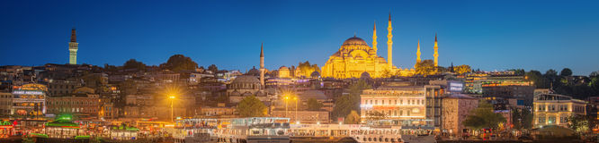 Istanbul skyline from Galata bridge by night Stock Image