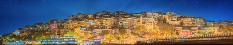 Istanbul skyline from Galata bridge by night Stock Photography