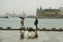 Istanbul steamboat pier people walking in the rain. Royalty Free Stock Photos